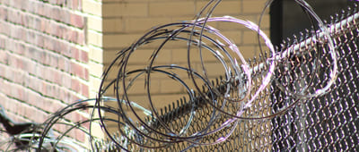 Galvanized Razor Barbed Wire on Top of the Fence